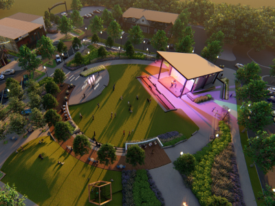 Rendering of downtown park and amphitheater with lights shining.