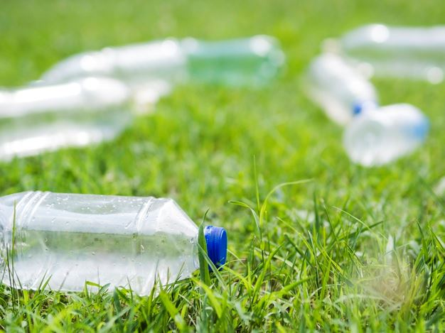 Plastic Water bottles strewn about the lawn.