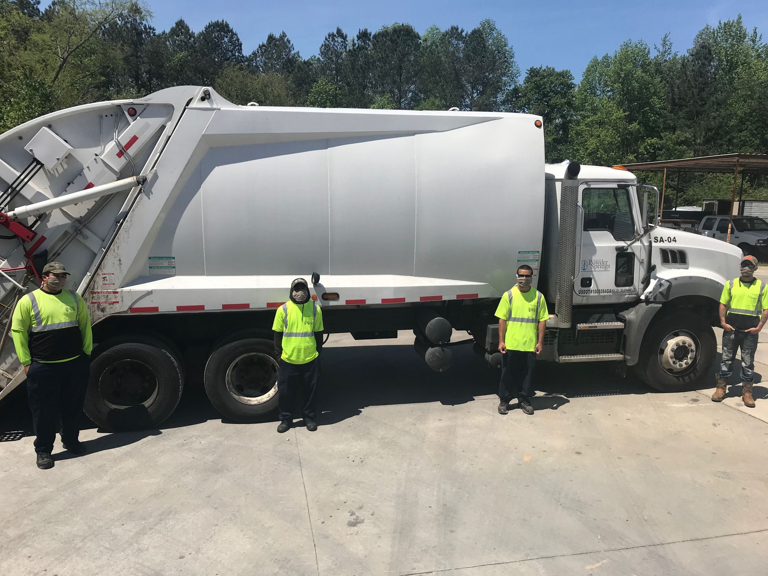 Powder Springs sanitation workers wearing PPE 4-20-20