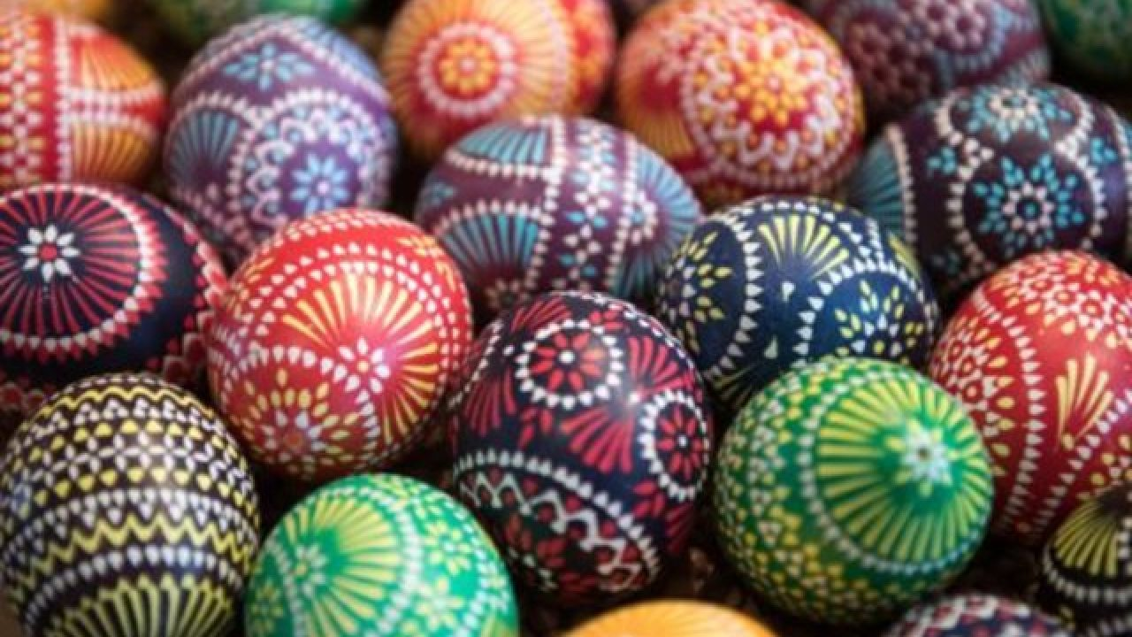 Multi colored Easter Eggs in a pile together.